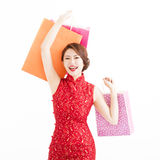 Young chinese woman holding shopping bags Royalty Free Stock Images