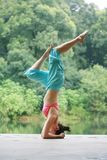 Young chinese woman practicing yoga outdoor Royalty Free Stock Photo