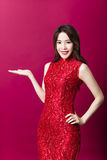 Young chinese woman with showing gesture Royalty Free Stock Photos