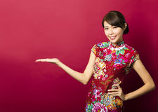 Young chinese woman with showing gesture Royalty Free Stock Photo