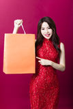Young chinese woman with showing  shopping bags Royalty Free Stock Photos