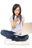 Young chinese woman talking in mobile phone Stock Image