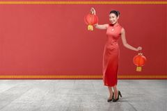 Young chinese woman in a traditional clothing holding red lanterns royalty free stock photography