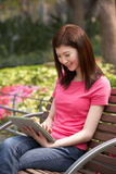 Young Chinese Woman Using Digital Tablet Royalty Free Stock Photography