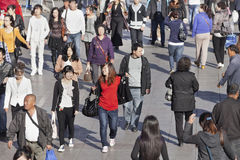Young Chinese women in a moving crowd. Young women in a moving crowd on October 14, 2012 in Dalian. China has a sex ratio with too few females. After Royalty Free Stock Photos
