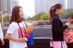 Young Chinese women play and take photos Royalty Free Stock Photo