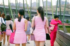 Young Chinese women play and take photos Royalty Free Stock Images