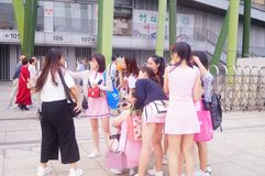 Young Chinese women play and take photos Royalty Free Stock Photography
