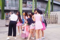 Young Chinese women play and take photos Stock Images