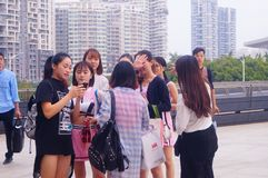 Young Chinese women play and take photos Royalty Free Stock Image