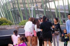 Young Chinese women play and take photos Stock Photo