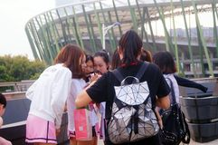 Young Chinese women play and take photos Stock Photography