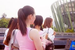 Young Chinese women play and take photos Royalty Free Stock Photos