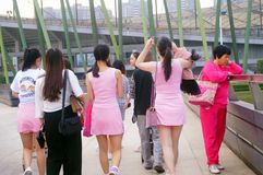 Young Chinese women play and take photos Stock Photos