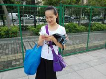 Young Chinese women are watching cell phones Royalty Free Stock Image