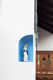 The young Christ Child and His mother Mary. Sculpture on the wall oh house Stock Image