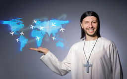 The young christian priest in air travel concept Stock Image
