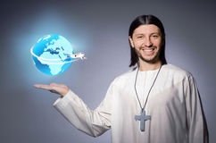 The young christian priest in air travel concept Royalty Free Stock Photo
