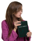 Young christian woman holding the bible. Horizontal picture of a young woman holding the Holy Bible Royalty Free Stock Photo