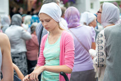 Young christian woman in white headscarf. Russia. Young christian woman in white headscerf among another women in Tolga monastery during celebration for icon of Royalty Free Stock Photo