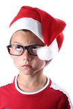 Young christmas boy. Young boy with santa hat and glasses stock images