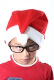 Young christmas boy. Young boy with santa hat and glasses stock photo