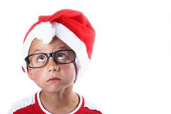 Young christmas boy. Young boy with santa hat and glasses royalty free stock photography