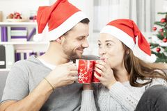 Young christmas couple enjoy time together Royalty Free Stock Image
