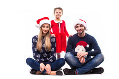 Young Christmas family sitting Royalty Free Stock Image