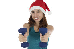 Young Christmas fitness woman with dumbells doing fitness Royalty Free Stock Image