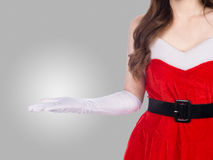 Young christmas girl holding something on gray Royalty Free Stock Image