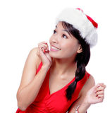 Young Christmas Girl looking up. Isolated on white background, model is a asian beauty Royalty Free Stock Images