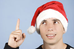 Young Christmas man pointing up royalty free stock images