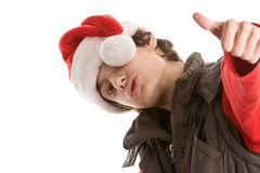 Young christmas man with thumbs up Stock Images