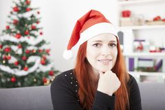 Young christmas red hair girl thinking Royalty Free Stock Photos