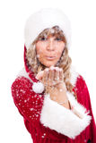 Young Christmas Woman is blowing snow. Young woman, dressed in a Christmas costume is blowing snow Stock Images