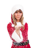 Young Christmas Woman is blowing snow. Young woman, dressed in a Christmas costume is blowing snow Stock Image