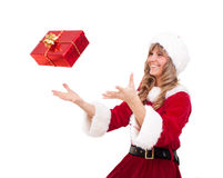 Young Christmas Woman is catching an xmas present Stock Images
