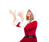 Young Christmas Woman is catching an xmas present Royalty Free Stock Photo