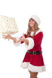 Young Christmas Woman is catching an xmas present. Young woman, dressed in a Christmas costume is catching an xmas present Royalty Free Stock Images