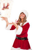 Young Christmas Woman is catching an xmas present. Young woman, dressed in a Christmas costume is catching an xmas present Royalty Free Stock Photos