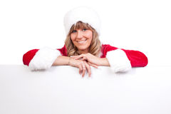 Young Christmas Woman on a copyspace label. Young woman, dressed in a Christmas costume on a copyspace label Royalty Free Stock Image