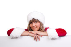 Young Christmas Woman on a copyspace label. Young woman, dressed in a Christmas costume on a copyspace label Stock Photography