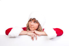 Young Christmas Woman on a copyspace label. Young woman, dressed in a Christmas costume on a copyspace label Royalty Free Stock Photos