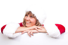 Young Christmas Woman on a copyspace label. Young woman, dressed in a Christmas costume on a copyspace label Stock Photo