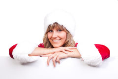 Young Christmas Woman on a copyspace label. Young woman, dressed in a Christmas costume on a copyspace label Royalty Free Stock Images