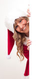 Young Christmas Woman on a copyspace label Royalty Free Stock Photos