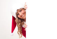Young Christmas Woman on a copyspace label. Young woman, dressed in a Christmas costume on a copyspace label Stock Images