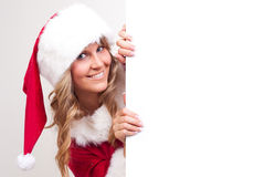 Young Christmas Woman on a copyspace label. Young woman, dressed in a Christmas costume on a copyspace label Royalty Free Stock Photography