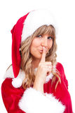 Young Christmas Woman is doing shh. Young woman, dressed in a Christmas costume is doing shh Royalty Free Stock Images